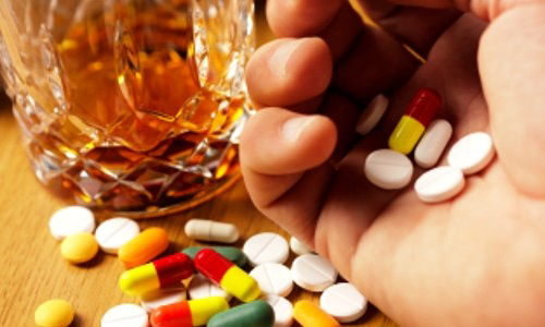 photo of multi-colored pills and a glass of alcohol - hired power breakaway - inpatient and outpatient drug alcohol detox